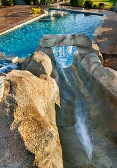 Pools With Slides beach entry swimming pool with a slide and waterfall | backyard