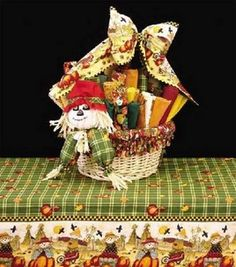 Scarecrow Basket with Bow  Here's a project you'll want to crow about! A little scarecrow makes for a lot of country charm to accent a table or a room.Skill Level: Some experience necessary Crafting Time: Varies Skill Level: Some experience necessary  add to project list