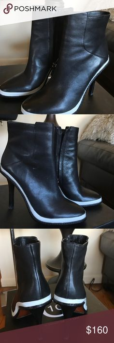 Derek Lam Boots Black and White Derek Lam Boots size 8 pre owned worn 2 times Great condition!  Leather Thanks for view Derek Lam Shoes Ankle Boots & Booties
