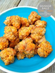 1 pound sausage  10 ounces shredded cheddar cheese  2 cups Bisquick Preheat the oven to 350°.  Mix all the ingredients together in a large mixing bowl and roll into one-inch balls.  Place on a foil-lined baking sheet and bake until golden-brown, about 20 minutes.
