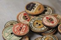 antique spool ends repurposed as buttons