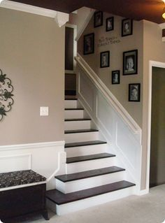 Staircase-remove carpeting, paint stairs, add molding along railing. Vacuuming carpeted Stairs is the WORST chore...ever!