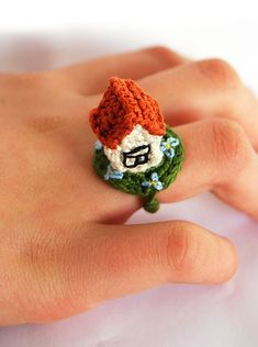 Crochet House Ring - a mini house on a ring, seriously cool!    I'll never make it, but it's darn cute.