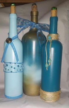Decorated wine bottles in blues and gold