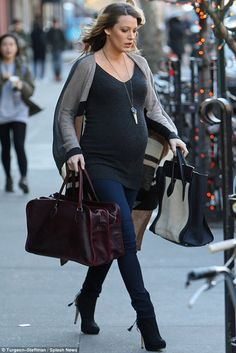 Bump on the run! Blake and husband Ryan Reynolds make a hurried exit out of their hotel in...