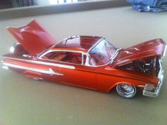 Rickys Kandy Tangerine HouseofKolor at Tru-Kandy. My friend painted this one too. Lowrider Model Cars, Diecast Model Cars, Model Cars Kits, Kit Cars, 1960 Chevy Impala, Truck Scales, Car Kits, Plastic Model Cars, Custom Paint Jobs