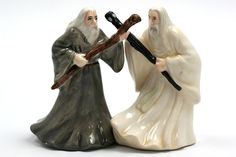 Gandalf & Saruman - Salt & Pepper Shakers. Glazed ceramic salt and pepper shakers. Featuring Gandalf and Saruman from Lord of the Rings. Magnets hold the two shakers together. Hand painted details. Rubber stopper at bottom for easy refill. $17.95.