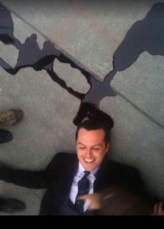 A smiling Moriarty inbetween scenes in The Reichenbach Fall. Sherlock.