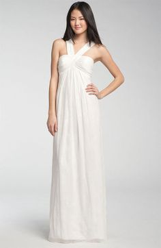 30 of the Best Beach Wedding Dresses For Any Bride-to-Be: A romantic neckline and unique floral burnout pattern set this gown apart.    DB Studio Floral Burnout Chiffon Gown ($215)  : Draw attention to flatter a fit upper body with the halter neckline on this ultraversatile gown.    Nicole Miller V-Strap Gown ($575)