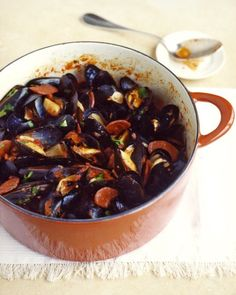 Spicy Mussels and Chorizo | Sweet, plump mussels are steamed in a sauce made with tomatoes, garlic, red chile flakes, and wine; chorizo, a Spanish sausage, adds extra heat.