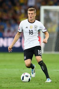 Toni Kroos of Germany runs with the ball during the UEFA EURO 2016 Group C match between Germany and Ukraine at Stade Pierre-Mauroy on June 12, 2016 in Lille, France.