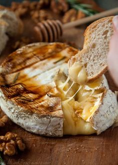 Baked Brie with Rosemary, Honey, and Candied Walnuts Served with Crusty French Bread. Warning: Do not make this for a party,if you want leftover Brie!