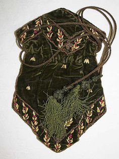 Reticule  Date: early 19th century  Culture: French  Medium: silk, metal, glass  Dimensions: Length: 10 1/4 in. (26 cm)  Credit Line: Gift of E. Dudley James, 1959  Accession Number: C.I.59.4  Metropolitan Museum of Art