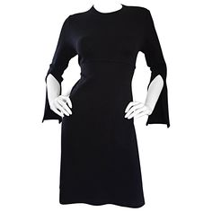 1990s Morgane Le Fay ' Slash Sleeve ' Black Long Sleeve Tie Belted Vintage Dress | From a collection of rare vintage day dresses at https://www.1stdibs.com/fashion/clothing/day-dresses/