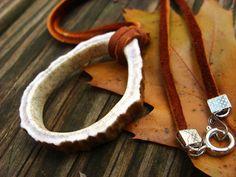 "Carved Antler Ring on ""Acorn"" Leather Cord, necklace / pendant. $18.86, via Etsy by WoodlandsWanderer"