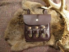 Distressed dark maroon leather belt pouch with 3 glass vials and insect specimens, all hand-stitched #175