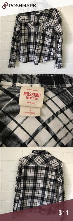 Black and white stripped flannel Fits more as a medium, good condition. Mossimo Supply Co Tops Button Down Shirts