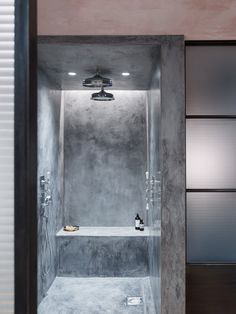 Bathroom: concrete shower stall with built-in seat, traditional chrome tapware…