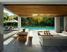 Beautiful pool and covered patio with wood ceiling.