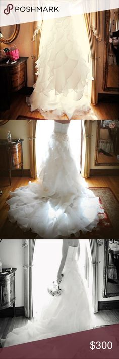 Organza Ruffled Wedding Gown Gorgeous organza ruffled wedding gown! Sweetheart neckline, strapless, ball gown, beautiful train, built in bustle. In excellent condition! Worn once, dry cleaned after use. Was altered to fit me so please refer to measurements.  Size 4 Dresses Strapless