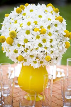"A yellow daisy centerpiece. A floral foam ball can be used as the top, filled with flowers and simply placed on top of the bright yellow vase. Flowers are daisy s and yellow ""billy balls"". Fresh Flowers, Beautiful Flowers, Daisy Flowers, White Flowers, Flowers Today, Sunflowers, Daisy Centerpieces, Centrepieces, White Centerpiece"