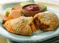 Grands!® Taco Melts; A tender, flaky biscuit wraps around your favorite taco fillings in an easy, flavor-packed hot sandwich.