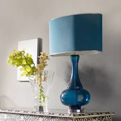 The finishing touch- aqua glass beside lamps and lime orchids Blue Glass Lamp, Aqua Glass, Glass Lamps, Free Interior Design, Interior Design Inspiration, Turquoise Lamp, Eclectic Furniture, I Love Lamp, Desk Light