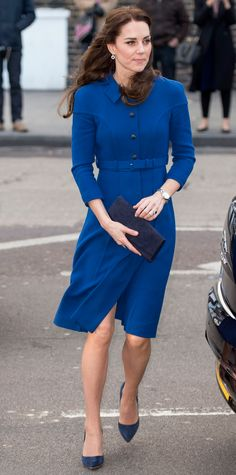 For a packed day of meets-and-greets, Kate Middleton went with a color scheme that played on shades of blue, starting with her royal blue fit-and-flare Eponine London coat dress and finishing with sapphire jewelry and a navy suede clutch and pumps.