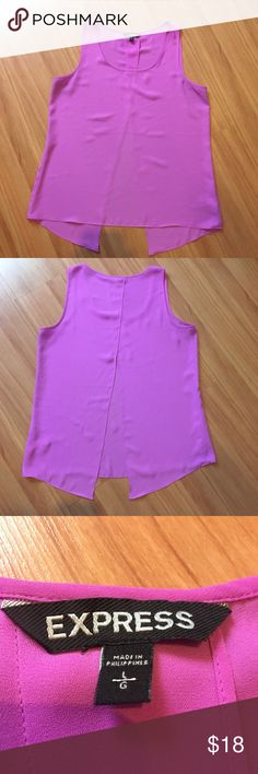 Express tank top Make a statement with this top. It has a slit back which gives it a loose fun and fun detail. No flaws. Like new Express Tops Tank Tops