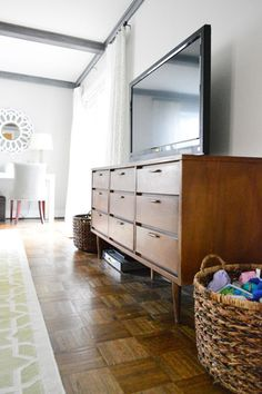 Mid-century modern dresser as a TV console -- cleaned with vinegar and Magic Erasers to look like new!