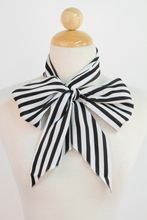 Striped Scarve  reminds me of Ms. Lovett from sweeney todd!