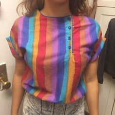 Vintage 70s Rainbow Crop Top Very funky vintage top I picked up at my favorite vintage shop. I love it, but I just never find myself wearing it. I think it would be more flattering on a taller person (I'm 5'4''). Would go great with some high waisted bell bottoms. All buttons are functioning, so this can be worn with the flap open. Tiny stain near the top button, that was there when I bought it. Seen in third photo. This has a blousey fit, so it's not noticeable when it's on. Vintage Tops…
