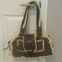 1 HOUR FLASH sale! NWOT BCBG MaxAzria handbag Brown/faux fur handbag, never used. BCBGMaxAzria Bags