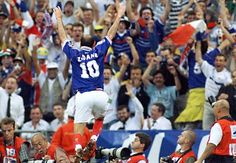 France's Zinedine Zidane jumps over the barrier as he celebrates his first goal during the 1998 World Cup final. 1998 World Cup, World Cup 2018, Fifa World Cup, Thierry Henry, Zinedine Zidane, Cristiano Ronaldo, Fifa 2022, French Celebrations, Music Pics
