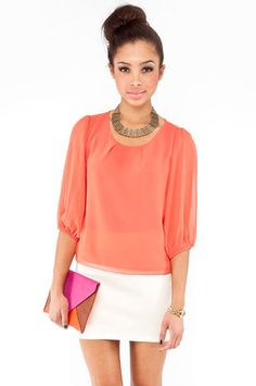Simple Zip Blouse in Orange $30 at www.tobi.com - This whole outfit is adorable, even the hair!!!