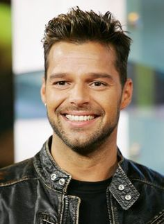 gay RickyMartin in leather jacket
