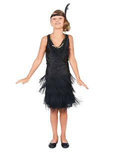 Déguisement charleston enfant fille : Ce déguisement de charleston pour fille se compose d'une robe et d'un bandeau (chaussures non incluses). La robe noire possède des franges sur cinq niveaux autour de la robe...
