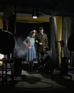 A solider and his bride pose for a portrait studio shot, 1942.