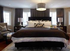 Bedroom. Bedroom Ideas. Stylish Gray Bedroom with Tailored Furniture and Draperies. #Bedroom #GrayBedroom #GreigeBedroom #BedroomIdeas Designed by Nest Design Studio.