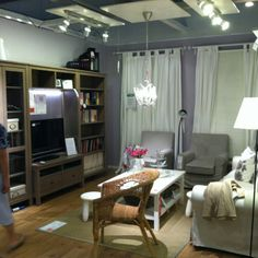 "Ikea showroom. Small living room (dimensions: 140""x155""x 102""). Hemnes entertainment center."