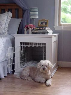 Build a bedside table around a wire dog kennel.  Paint it white and add molding to dress it up.
