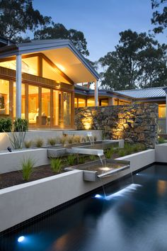 The stainless steel water features connect the house to the pool