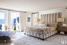 Khloé's master suite features a bespoke bed upholstered in a Colefax and Fowler fabric; the center pillow is by Hermès, the throw is by Fendi, the curtains are of a Holland & Sherry linen, and the alpaca carpet is by the Rug Company.