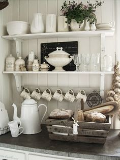 White dishes, kettle and rustic basket.