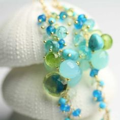 Semi-precious stones.  Endless Cascade Earrings in Aqua Blues and Greens by Fussjewelry