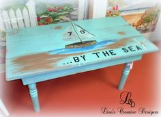 Painted wood coffee table with seascape, sailboat and sea saying.