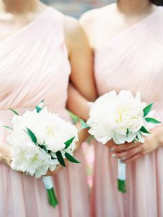 Soft pink bridesmaids dresses from J.Crew and small white bouquets- so lovely!