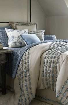 Beautiful and blue, bed ensemble.