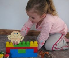I love interactive activities! A Humpty Dumpty finger puppet and simple blocks. Fun!