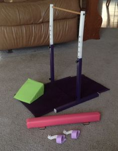 Homemade American Girl Doll McKenna's gymnastic set.  My dad made parallel bar with metal and plastic (it raises and lowers), I made mats, beam and grips.